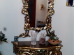 a beautiful mirror and console